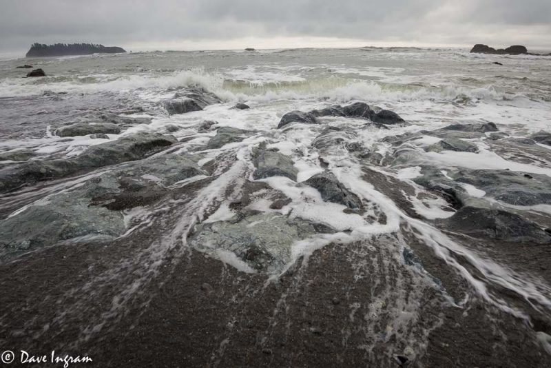 Water Flowing over Rocks and Beach
