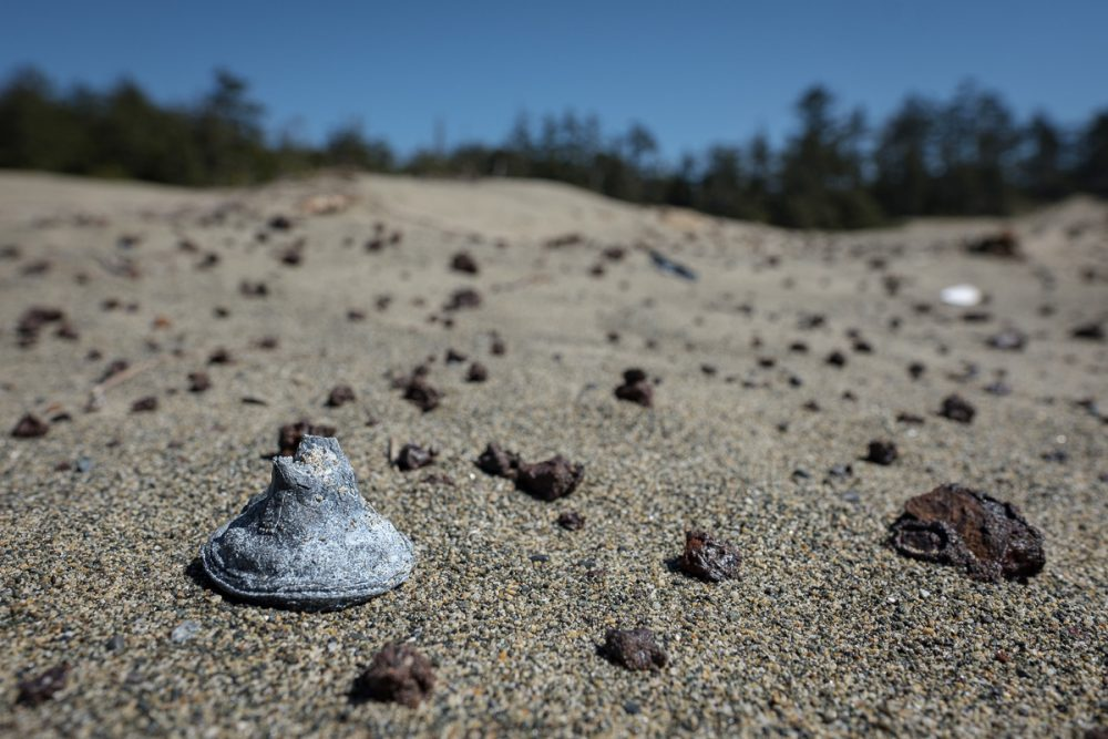 Cap chamber and grenade fragments in the dunes at Wickaninnish Beach.